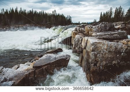 Waves And Splashes Of Mountain River On Background Of Forest And Dramatic Sky. Forest River Water La