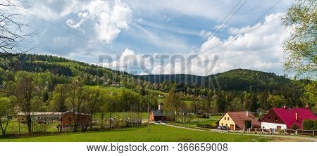 Krasna Village With Dispersed Settlement And Hills Of Moravskoslezske Beskydy Mountains Around In Cz
