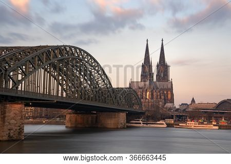 Cologne, Germany - March 18, 2020: Panoramic Image Of The City Skyline With Cathedral And Bridge Ove