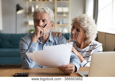Unhappy Depressed Family Married Couple Having Financial Trouble.