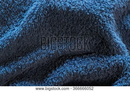 Embossed Blue Surface Of The Fabric Towel With Villi. Fleecy Relief Texture Background.