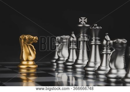 Leadership. Gold Horse Chess With Silver Chess Pawns Pieces On Chess Board Game Competition On Dark