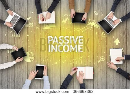 Group of Busy People Working in an Office with PASSIVE INCOME inscription, succesfull business concept