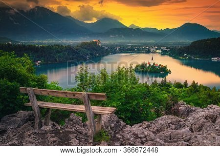Majestic Resting Place With Wooden Bench On The Top Of Mountain. Great View With Small Island In The