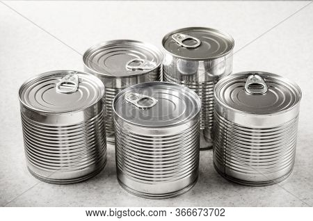 Set Of Various Canned Foods In Tin Cans On Kitchen Table, Non-perishable, Long Shelf Life Food For S