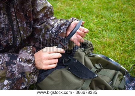 A Hunter With A Knife. Sharp Cold Steel Hunting Weapons. Hunting Military Gear And Equipment. A Woma