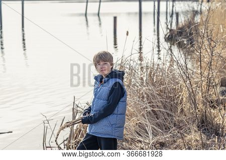 Portrait Of A Teen Boy In Front Of A Lake