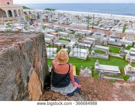 San Juan, Puerto Rico - May 08, 2016: The Woman Sitting Near Old Cemetery At San Juan At Puerto Rico
