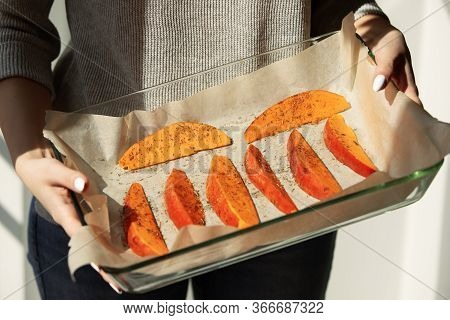 Close Up Woman Hands Holding Slices Of Raw Sweet Potato With Herbs And Spices In Glass Dish On Bakin
