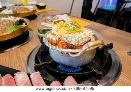 Korean food of army stew or army base stew (Budae Jjigae) in the restaurant