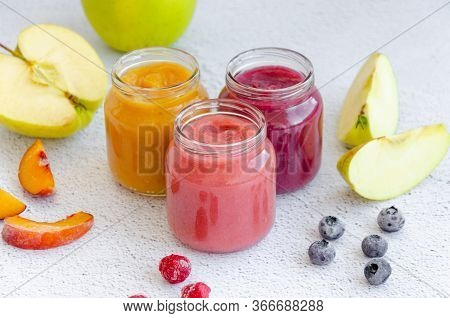 Baby Food. Homemade Fruit Puree. Variety Of Apple Puree Or Applesauce With Frozen Peach, Raspberries