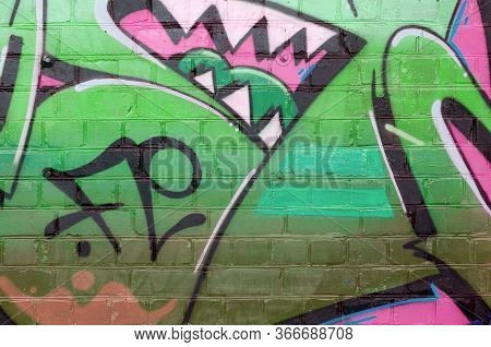 Abstract Colorful Fragment Of Graffiti Paintings On Old Brick Wall In Pink And Green Colors. Street