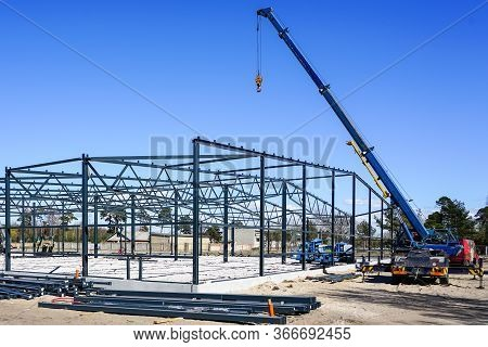 Metal Frame Of A Modern Industrial Building In The Construction Process