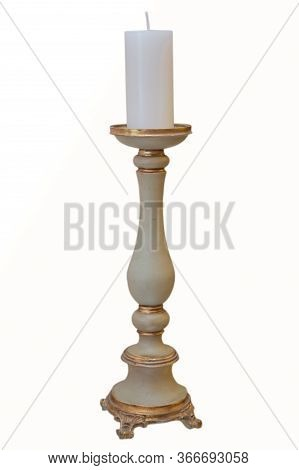 White Candle . Brass Candle Holder . Old Brass Candle Holder On White Background .