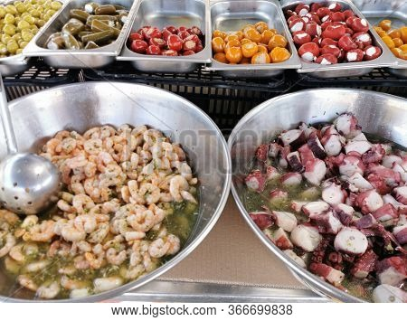 Pickled Octopus, Shrimp, Seafood In The Spanish Market, Traditional Spanish Cuisine, Pickles And Mar