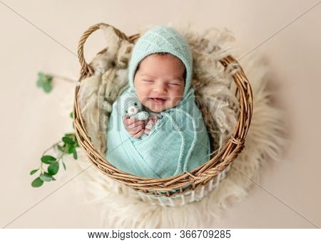 Funny newborn smiling in sweet dream