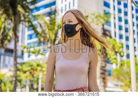 Fashionable Black Medical Mask With Filter In The City. Coronavirus 2019-ncov Epidemic Concept. Woma