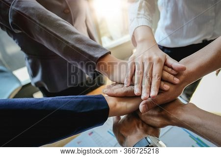 Teamwork Success. Business People Group Team Happy Showing Teamwork And Joining Hands After Meeting