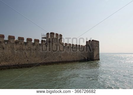 Italy, Lombardy - August 05 2018: The View Of The Scaliger Castle Wall On Lake Garda On August 05 20