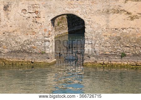 Italy, Lombardy - August 05 2018: The View Of Swan And Duck Behind Fence At The Scaliger Castle Entr