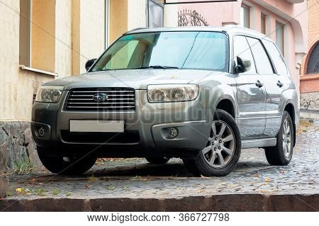 Uzhgorod, Ukraine - Oct 13, 2013: Silver Subaru Forester Suv On The Pavement. Autumn Weather With Ye