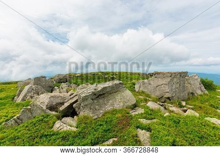 Huge Stones In Valley On Top Of Mountain Ridge. Mountain Summer Landscape. Meadow With Huge Stones A