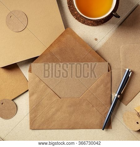 An Assortment Of Brown Kraft Papers, With An Envelope, A Greeting Card, A Notebook, A Label, Overhea