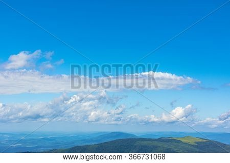 White Fluffy Clouds On The Blue Sky. Beautiful Nature Scenery In Mountains