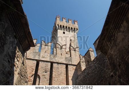Italy, Lombardy - August 05 2018: The View Of The Walls And Bridge Of Scaliger Castle On August 05 2