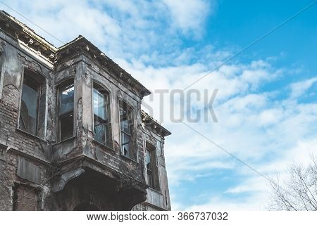 Beautiful Historic Multi-storey Building Abandoned Against The Blue Sky. Beautiful Old European-buil