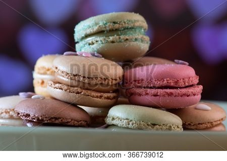 Beautiful Colorful Macarons On Black Background, Close Up View