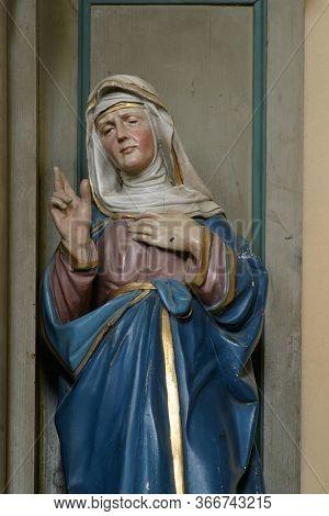 KAMANJE, CROATIA - JULY 02, 2016: Saint Anne, statue on the altar of St. Valentine in the Parish Church of the Holy Name of Mary in Kamanje, Croatia