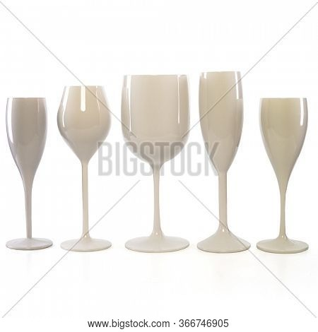 Five white wine glasses for gourmets. Isolated glasses on wite background for festive events