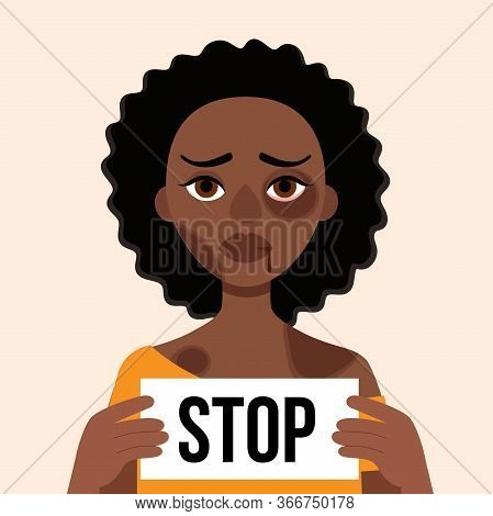 Sad African Woman With Bruises And Wounds On A White Background.holding Leaf With Words Stop.concept