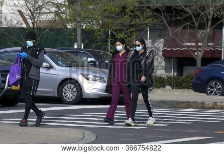 Bronx, New York/usa - April 20, 2020: Women Cross Street While Wearing Surgical Masks During Coronav