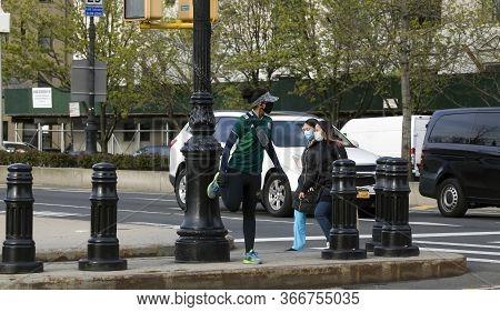 Bronx, New York/usa - April 20, 2020: Woman Runs Wearing Mask During Covid-19 Pandemic.