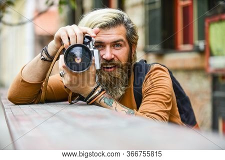 Just Smile. Travel Tips. Professional Photographer Use Vintage Camera. Bearded Man Hipster Take Phot