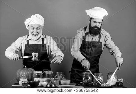 Homemade Meal. Prepare Food. Culinary Recipe. Culinary Book. Chef Men Cooking. Father And Son Culina