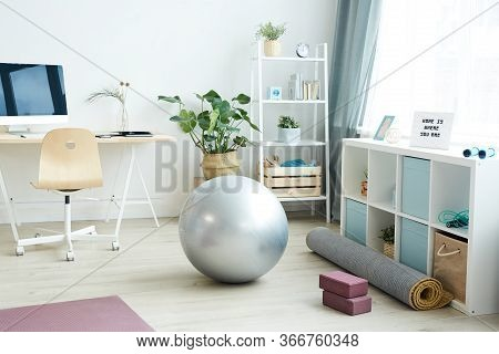Background Image Of Various Sports Equipment On Floor In Small Apartment Studio, Home Workout Concep