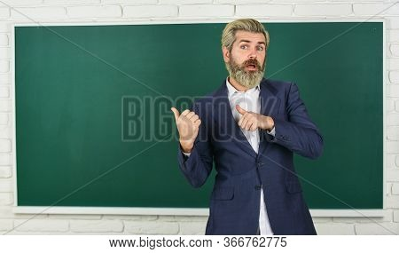 Teacher Explain Topic. Man Teacher In Front Of Chalkboard. Have Good Grade Point Average In High Sch