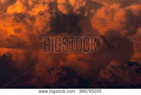 Red, Orange Fluffy Clouds On Sunset Sky Background. Art Picture Of Orange Clouds Texture. Beautiful