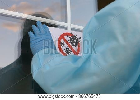 Disinfection Sign Is Glued To The Front Enter Door. Coronavirus Disinfection Is Performed Indoors. M