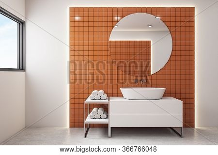 Modern Orange Bathroom With Mirror And Comfortable Bathtub And Blue Sky In Window. Style And Hygiene