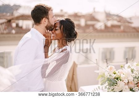 Destination Fine-art Wedding In Florence, Italy. Caucasian Groom And African-american Bride Cuddling