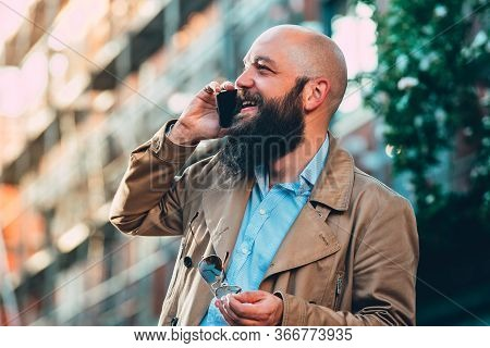 Man Portrait With Cell Phone. Man Portrait While Speaking On Cell Phone. Man Portrait Speaking On Ph