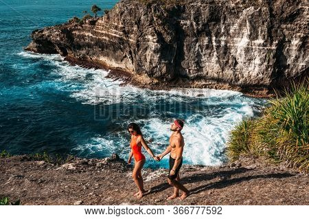 A Couple In Love Is Vacationing On The Island Of Bali. Man And Woman On The Island. Sea Tour. Honeym