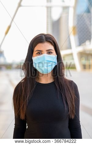 Young Indian Woman Wearing Mask For Protection From Corona Virus Outbreak At The Skywalk Bridge