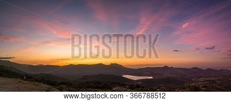 Panoramic View Of Sunset Over The Regino Valley, Lac De Codole And The Mediterranean Sea In The Bala