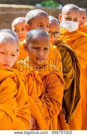 Kathmandu, Nepal - October 27, 2018 : Little Buddhist Monks In Boudhanath Stupa Kathmandu During Bud