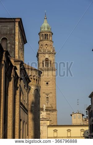 Exterior Of The Medieval Cathedral (duomo) Of Parma, Emilia-romagna, Italy, And Belfry Of San Giovan